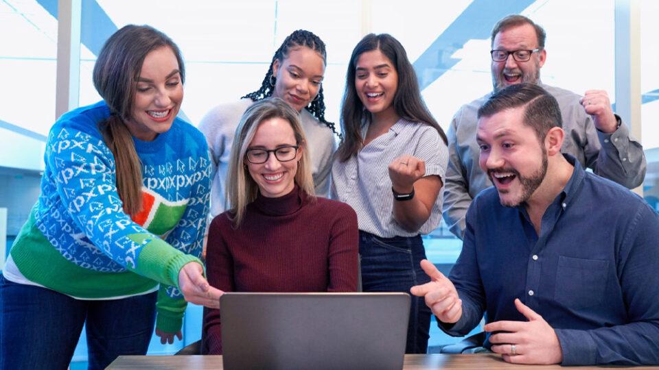 NSDC students looking at a computer
